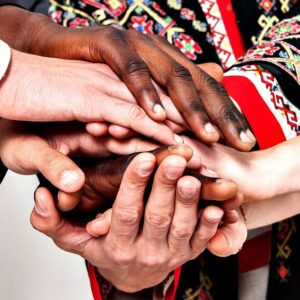 Multi-racial hands joined or stacked showing solidarity